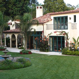 Example of a tuscan two-story exterior home design in Los Angeles