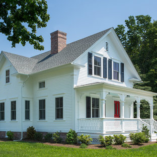 Mid-sized ornate white two-story concrete fiberboard exterior home photo in Providence with a shingle roof