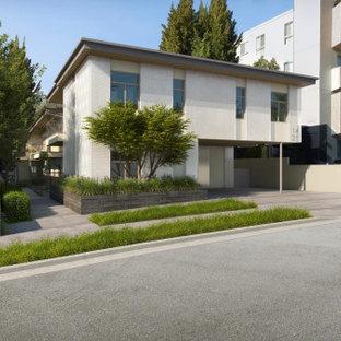 Inspiration för mycket stora moderna lägenheter, med två våningar och stuckatur