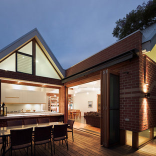 Inspiration for a medium sized and red contemporary one floor brick exterior in Melbourne with a pitched roof.