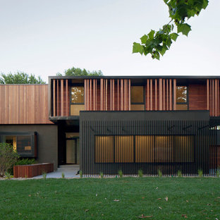 Example of a minimalist two-story wood flat roof design in Kansas City