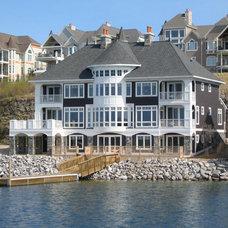 Beach Style Exterior by Falcon Custom Homes