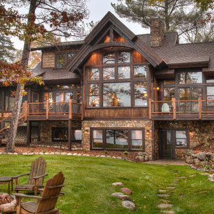 Large mountain style brown two-story wood gable roof photo in Minneapolis