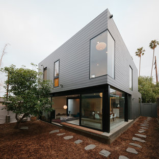 Gey and medium sized contemporary two floor exterior in Los Angeles with concrete fibreboard cladding and a flat roof.