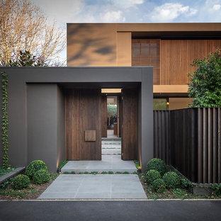 Idées déco pour une grand façade de maison marron scandinave à un étage avec un toit plat.