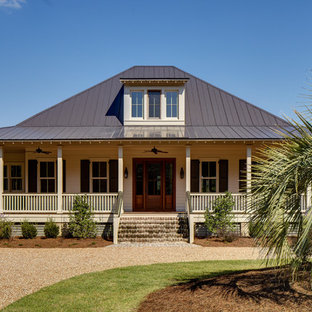Inspiration for a small tropical two-story exterior home remodel in Atlanta with a hip roof