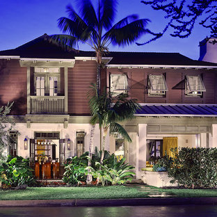 Large tropical multicolored two-story mixed siding exterior home idea in Los Angeles with a mixed material roof