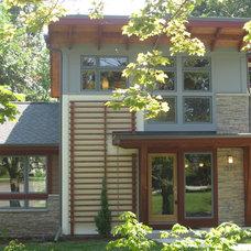 Contemporary Exterior by 1128 Arch Design
