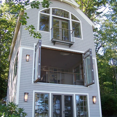 Large traditional gray three-story mixed siding exterior home idea in Portland Maine with a shingle roof