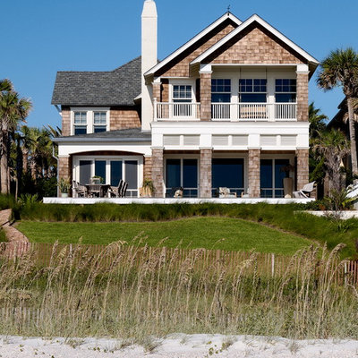 Example of a beach style two-story wood gable roof design in Jacksonville