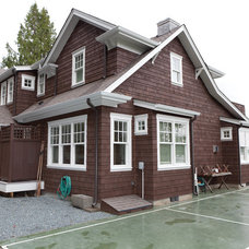 Beach Style Exterior by Sykora Home Design