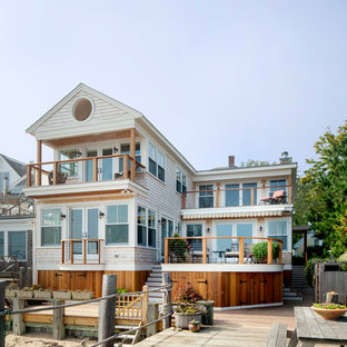 Inspiration for a mid-sized timeless beige two-story wood gable roof remodel in Boston