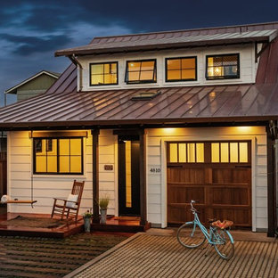 Coastal white two-story house exterior idea in San Francisco with a metal roof