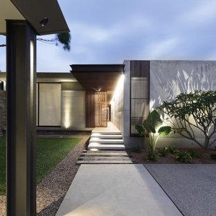 Idéer för mellanstora funkis grå hus, med två våningar, platt tak och tak i metall