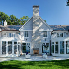 Beach Style Exterior by Highgate Builders