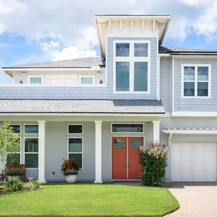 Mid-sized beach style blue two-story wood house exterior idea in Jacksonville with a hip roof and a shingle roof