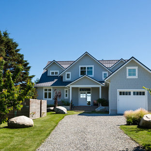 Mid-sized beach style gray two-story concrete fiberboard exterior home idea in Seattle with a metal roof