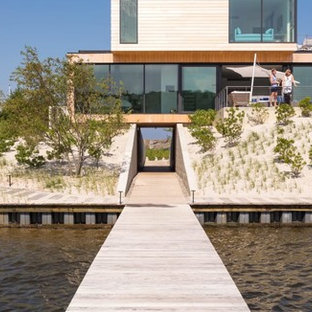 Inspiration for a mid-sized beach style brown two-story wood exterior home remodel in New York