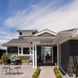 Example of a coastal gray one-story exterior home design in Seattle