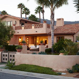 Southwest beige two-story exterior home photo in Other with a tile roof