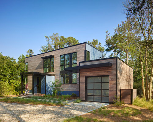 Beach Style Two Story Wood Flat Roof Idea In Wilmington