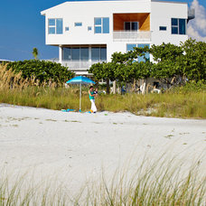 Beach Style Exterior by Traction Architecture