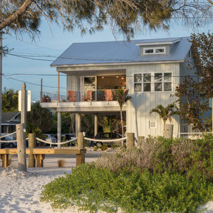 Small beach style gray two-story gable roof idea in Tampa with a metal roof