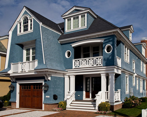 This is an example of a large victorian exterior in other with three - Prussian Blue Exterior Stain Home Design Ideas Pictures