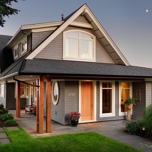 Inspiration for a transitional beige two-story wood exterior home remodel in Other with a shingle roof