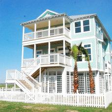 Tropical Exterior by Seaside Construction - Custom Home Builder
