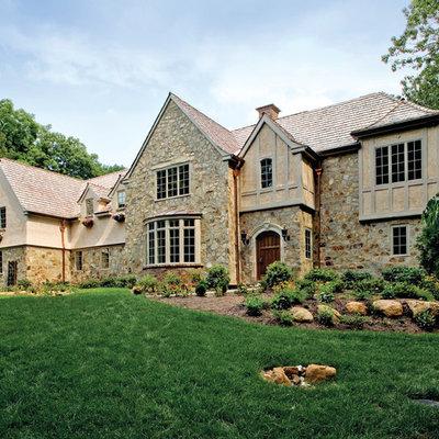 Elegant two-story stone exterior home photo in Philadelphia
