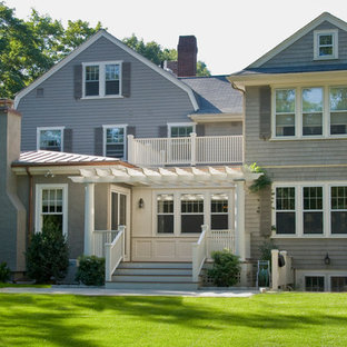 Example of a classic gray exterior home design in Boston