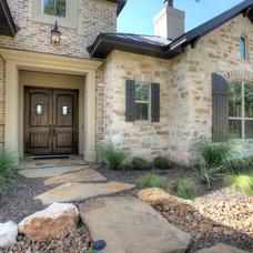Rustic Exterior by Garner Homes