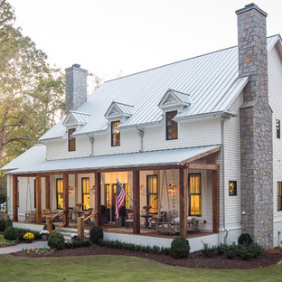 Inspiration for a large farmhouse white two-story gable roof remodel in Atlanta with a metal roof