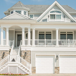 Traditional gray three-story wood exterior home idea in New York