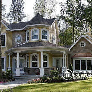 Inspiration for a large victorian yellow two-story mixed siding exterior home remodel in Portland Maine