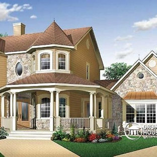 Example of a large ornate beige two-story vinyl exterior home design in Montreal