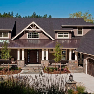 Large craftsman brown three-story exterior home idea in Seattle