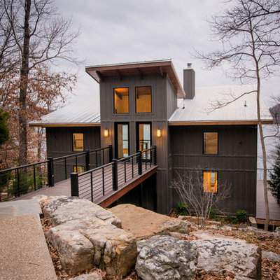 Inspiration for a large rustic gray two-story metal house exterior remodel in Birmingham with a shed roof and a metal roof