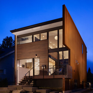 Small modern red two-story wood flat roof idea in Seattle