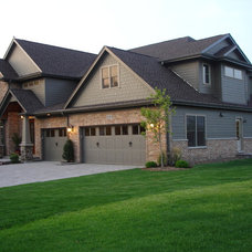 Traditional Exterior by Midwest Construction Company of Barrington Inc