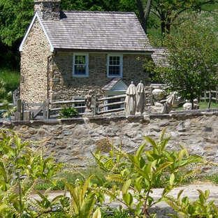 Inspiration for a farmhouse two-story stone exterior home remodel in Philadelphia