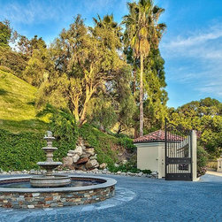 Bel Aire Falconview - Day time view of the inside gate at the Falconview Estate. This gate designed, fabricated and installed by GatesLosAngeles.com, a division of Mulholland Security Centers in Los Angeles.
