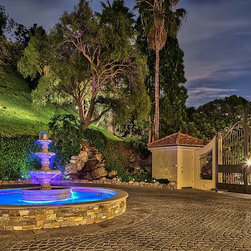 Bel Aire Falconview - Night time view of the inside gate at the Falconview Estate. This gate designed, fabricated and installed by GatesLosAngeles.com, a division of Mulholland Security Centers in Los Angeles.