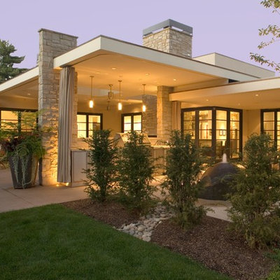 Inspiration for a 1950s one-story flat roof remodel in Denver
