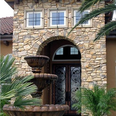 Traditional Exterior by Taylor Design