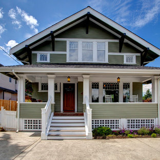 Inspiration for a craftsman green two-story exterior home remodel in Seattle