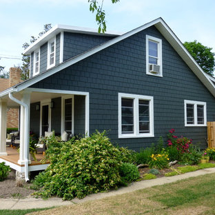 Inspiration for a mid-sized timeless gray two-story wood exterior home remodel in New York with a hip roof