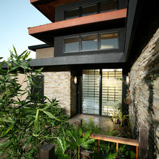 Asian Exterior by Silva Studios Architecture
