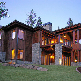Large traditional gray two-story wood exterior home idea in Seattle